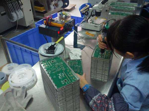 putting protective coating (black dot) over the chip on board